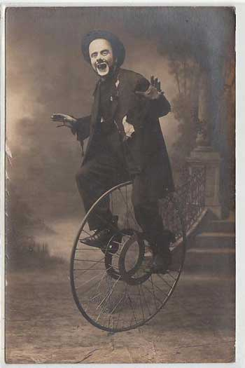 Postcard of a French clown on a bicycle