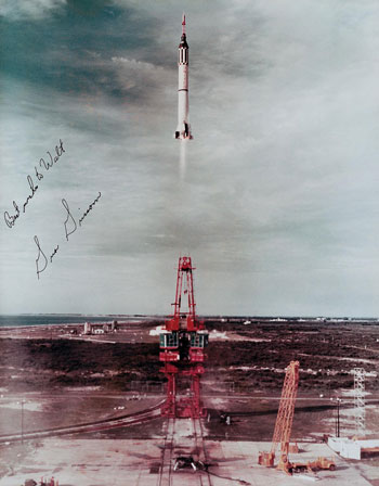 Six Mercury launch photographs from 1958 signed by the Mercury astronauts.